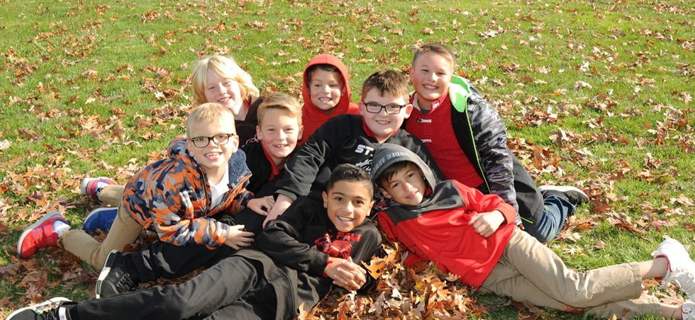 St. Paul students pose together in a fall setting.